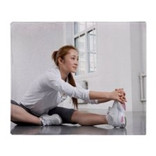 Young Woman Stretching Throw Blanket