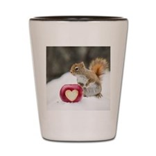 Squirrel standing in snow with apple Shot Glass