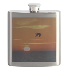 Pelican flying into orange sunset Flask