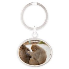 Grooming monkeys Oval Keychain