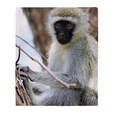 Vervet monkey on tree Throw Blanket