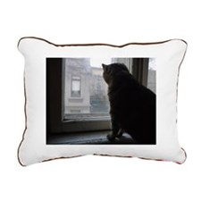 A cat looking out of the Rectangular Canvas Pillow