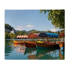 Boats on Bled lake with reflection Throw Blanket