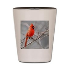 Male cardinal perched against grey sky Shot Glass