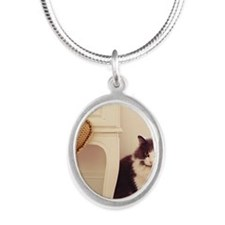 Green eyed cat in pretty hous Silver Oval Necklace