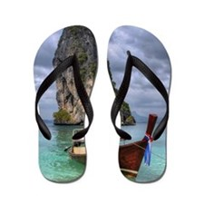 Long Tail Boat floating on turquoise wa Flip Flops