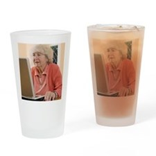 Elderly woman using a laptop comput Drinking Glass