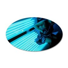 Woman getting off a sunbed Wall Decal