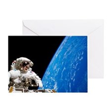 Astronaut performing a spacewalk Greeting Card