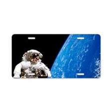 Astronaut performing a spac Aluminum License Plate