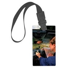 Car driver using hand-held GPS r Luggage Tag