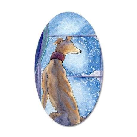 Greyhound watching snow fall 35x21 Oval Wall Decal