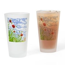 Red Sneezeweed flowers against blue Drinking Glass