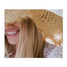 Smiling young woman wearing straw ha Throw Blanket