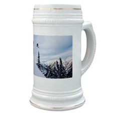 A skier jumping off a cliff in the backcount Stein