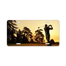 Golfer swinging club on gol Aluminum License Plate
