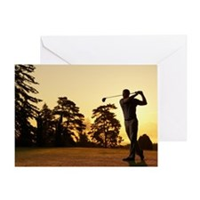 Golfer swinging club on golf course  Greeting Card