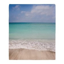 Beach scene with blue sky, turquoise Throw Blanket