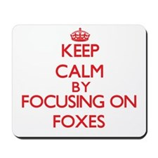 Keep calm by focusing on Foxes Mousepad