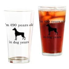 70 birthday dog years doberman Drinking Glass