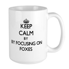 Keep calm by focusing on Foxes Mugs