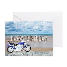 Birthday card with a motor bike on a beach. Greeti