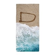 LETTERS IN SAND D Beach Towel