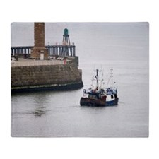 Fishing boat and stone piers Throw Blanket