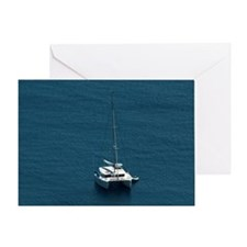 Catamaran moored offshore Greeting Card