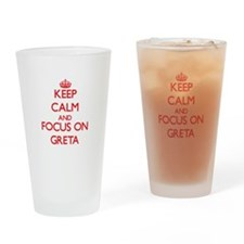 Keep Calm and focus on Greta Drinking Glass
