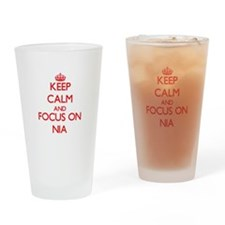 Keep Calm and focus on Nia Drinking Glass