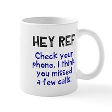 Hey Ref check your phone Mugs