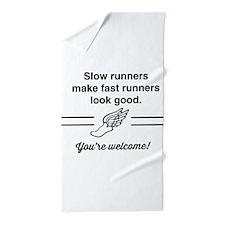 Slow runners make fast look good Beach Towel