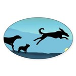 Dogs Chasing Ball Oval Sticker