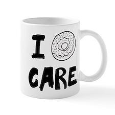 I DOUGHNUT CARE. I DON'T CARE. Mugs