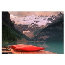 Canoes Lined On A Dock, Lake Louise, Banff Nationa