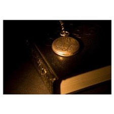 Gold Pocket Watch Resting On A Book