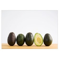 A Row Of Avocados With Interior Of One Showing Sta