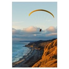 California, La Jolla, Paraglider flying over ocean