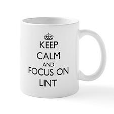 Keep Calm and focus on Lint Mugs
