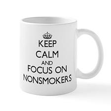 Keep Calm and focus on Nonsmokers Mugs