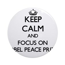 Keep Calm by focusing on Nobel Pe Ornament (Round)
