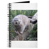 Pallas cat hissing on a Journal