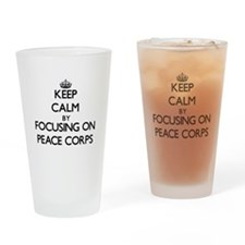 Keep Calm by focusing on Peace Corp Drinking Glass
