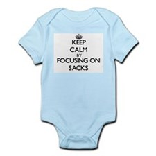 Keep Calm by focusing on Sacks Body Suit