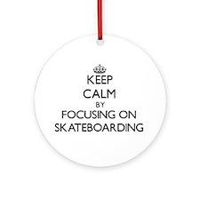 Keep Calm by focusing on Skateboa Ornament (Round)
