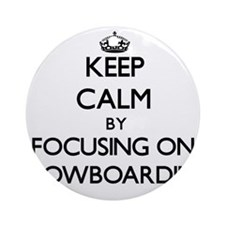 Keep Calm by focusing on Snowboar Ornament (Round)