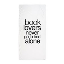 Book lovers never go to bed alone Beach Towel