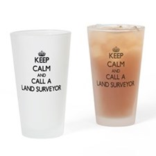 Keep calm and call a Land Surveyor Drinking Glass