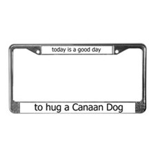 Hug a Canaan Dog License Plate Frame